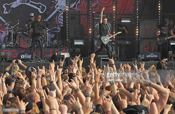 Heavy metal music fans watch a performance by thrash band FreiWild on the first day of the Wacken Open Air heavy metal music fest on August 4 2011 in...
