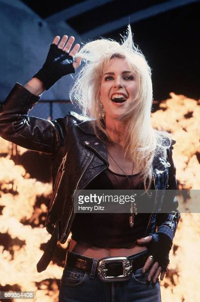 Heavy metal rock singer Lita Ford sings during the filming of a music video at Sepulveda Dam near Los Angeles