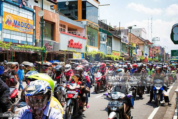 Heavy motorbike traffic downtown Yogyakarta Indonesia