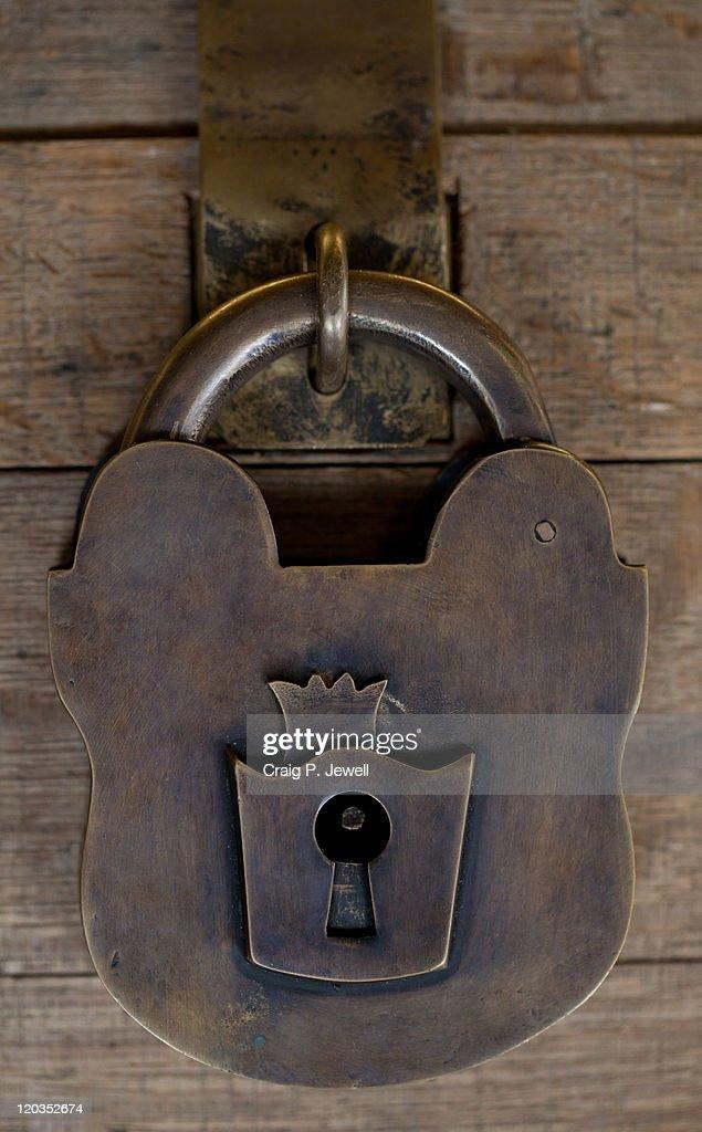 Heavy old brass lock : Stock Photo