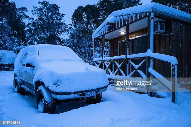 Heavy overnight snowfall covers cars and cabins in the park on July 13 2016 in Cradle Mountain Australia The Bureau of Meteorology has issued a...