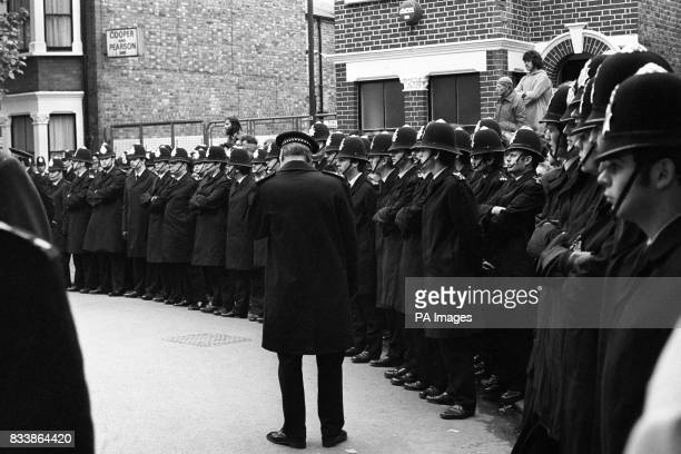 A heavy police guard outside the Grunwick film processing factory The police were holding back the picket line