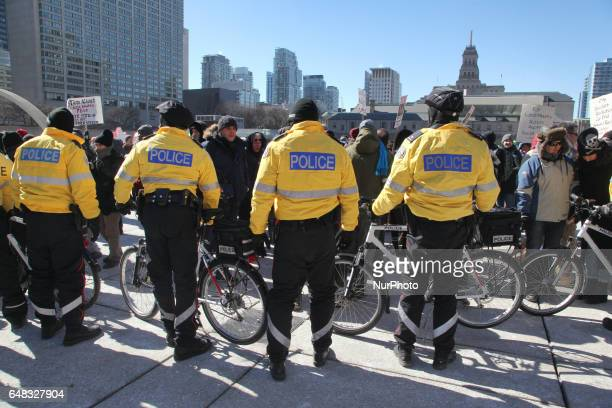 Heavy police presence as opposing groups of protesters clashed over the M103 motion to fight Islamophobia in downtown Toronto Ontario Canada on March...