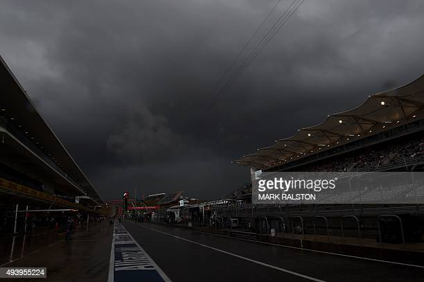 Heavy rain and storm clouds hover over pit lane as the second practice session is postponed during the United States Formula One Grand Prix at the...