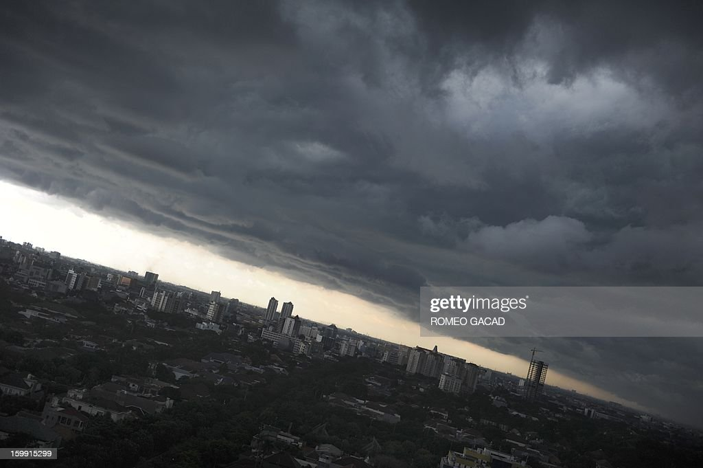 Heavy rain clouds hang over the Indonesian capital city of Jakarta on January 23, 2013 as government weather bureau forecasts more rain while parts of the city remains submerged from flood waters for a week. Indonesia's wet season last from February to March.