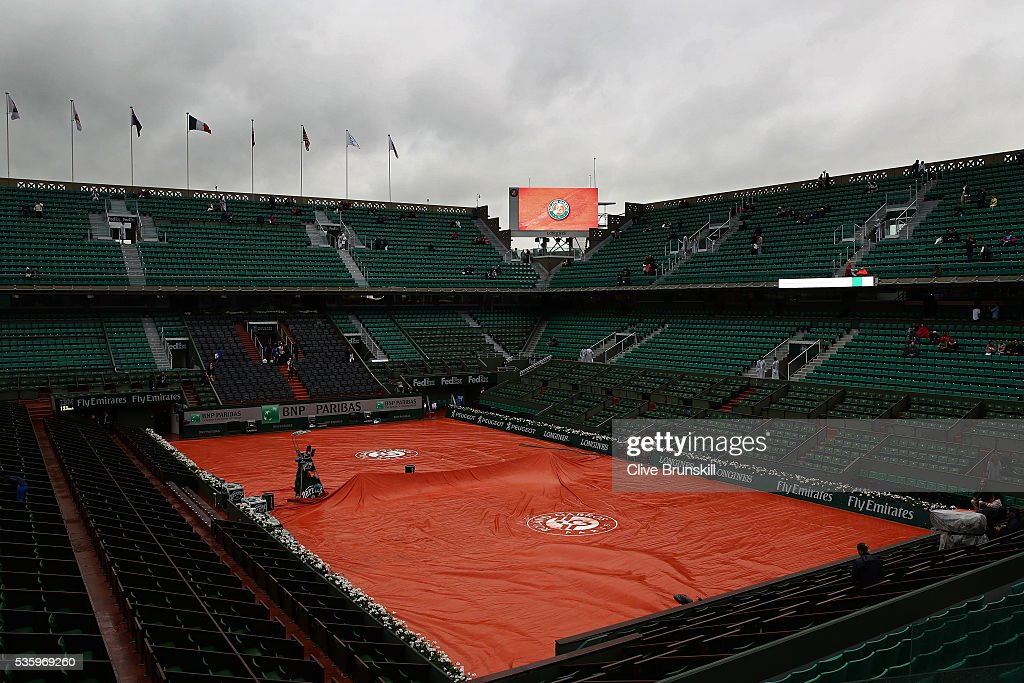 Heavy rain delays the start of the day's play on day ten of the 2016 French Open at Roland Garros on May 31, 2016 in Paris, France.