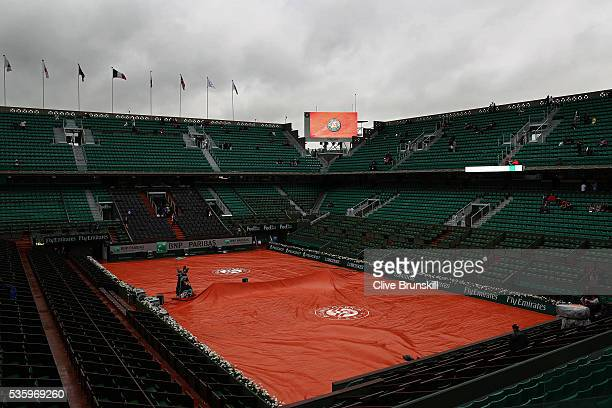 Heavy rain delays the start of the day's play on day ten of the 2016 French Open at Roland Garros on May 31 2016 in Paris France