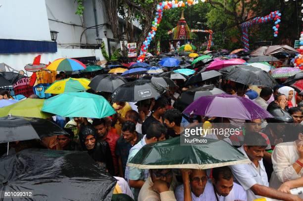 Heavy Rain Devotees take part in Jagannath Rath Yatra organised by ISKCON 46th Rath Yatra on June 252017 in Kolkata IndiaThe three deities of...