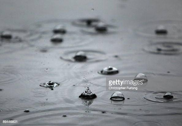 Heavy rain drops fall and create bubbles in a puddle as incessant rain continues to fall on July 29 2009 in Walsall United Kingdom The MET office has...