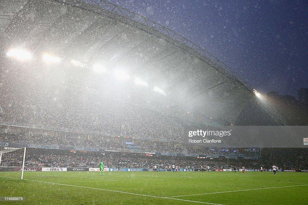 Heavy rain falls during the Barclays Asia Trophy Semi Final match between Tottenham Hotspur and Sunderland at Hong Kong Stadium on July 24, 2013 in So Kon Po, Hong Kong.