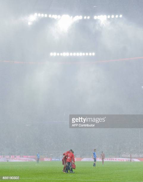 Heavy rain falls during the German First division Bundesliga football match FC Bayern Munich vs Bayer 04 Leverkusen in Munich southern Germany on...