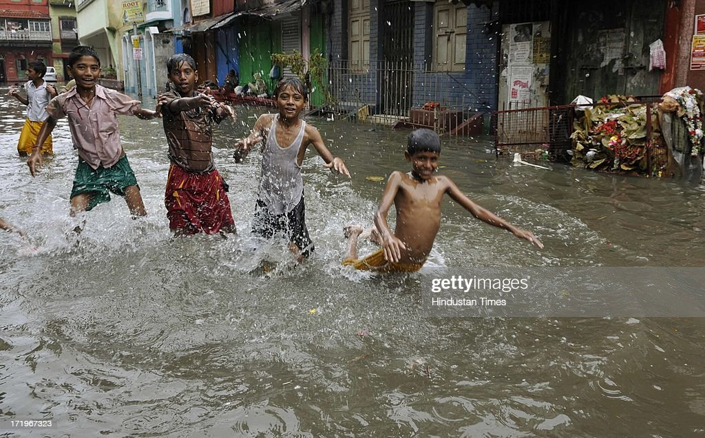 Heavy rains disrupted normal life as several parts of the city became waterlogged at Thantania Kali Bari on June 30 2013 in Kolkata, India. According to the MeT office 89.5 mm rainfall was recorded in last 24 hours. The heavy rainfall partially disrupted train services at various parts of Sealdah section, while that of Eastern Railways section was restored later in the day.