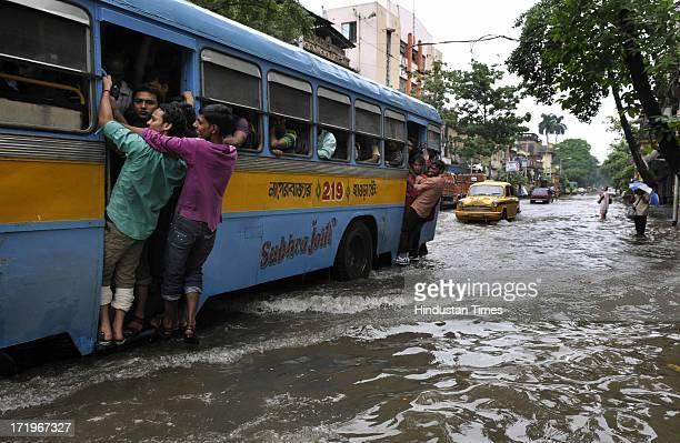 Heavy rains disrupted normal life as several parts of the city became waterlogged at Thantania Kali Bari on June 30 2013 in Kolkata India According...