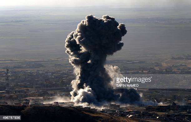 Heavy smoke billows during an operation by Iraqi Kurdish forces backed by USled strikes in the northern Iraqi town of Sinjar on November 12 to retake...