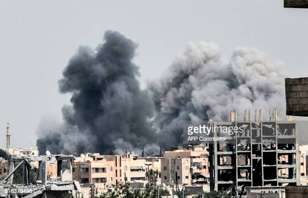 Heavy smoke billows following an airstrike on the western frontline of Raqa on July 17 during an offensive by the USbacked Syrian Democratic Forces a...