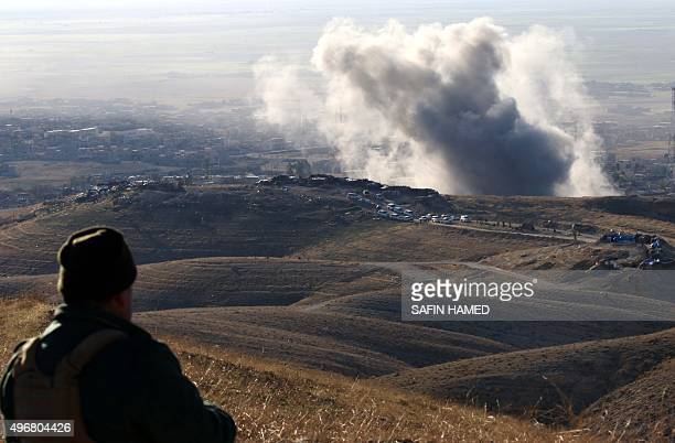 Heavy smoke billows from the northern Iraqi town of Sinjar during an operation by Iraqi Kurdish forces backed by USled strikes on November 12 to...