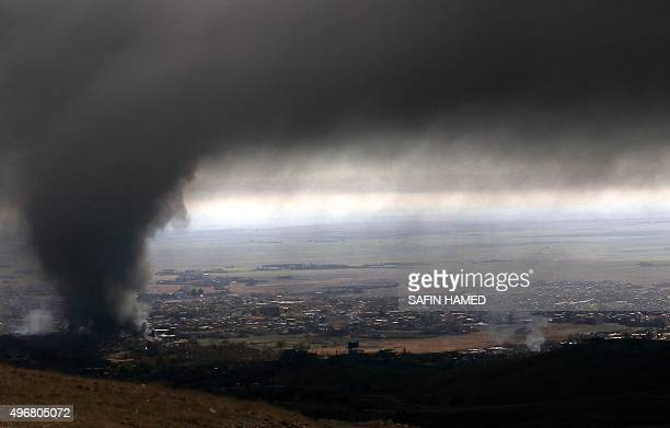 Heavy smoke covers the northern Iraqi town of Sinjar during an operation by Iraqi Kurdish forces backed by USled strikes on November 12 to retake the...
