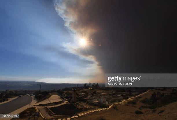 TOPSHOT Heavy smoke covers Ventura as flames reach the coast during the Thomas wildfire near Ventura California on December 6 2017 California...