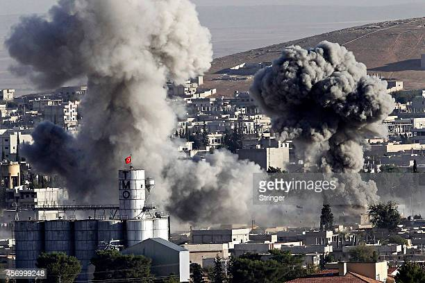 Heavy smoke from a fire caused by a strike rises in Kobani Syria as fighting intensified between Syrian Kurds and the militants of Islamic State...