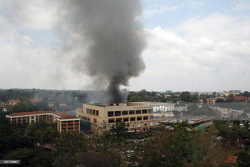 Heavy smoke is seen from the site of the terrorist attack, Westgate Mall, on September 23, 2013 in Nairobi, Kenya. The attack occurred on Saturday, 10-15 gunmen from the extremist group Al-Shabab entered the mall and opened fire at random on shoppers; 68 deaths have been confirmed.