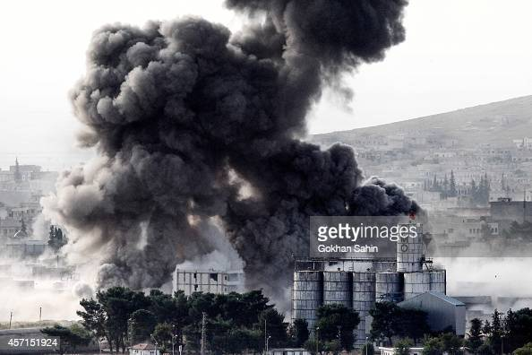 Heavy smoke rises following an airstrike by the USled coalition aircraft in Kobani Syria during fighting between Syrian Kurds and the militants of...