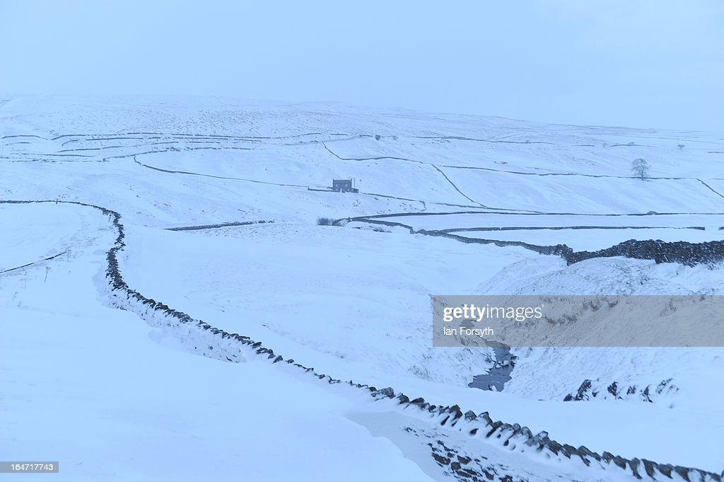 Heavy snow covers the fells between Kirkby Stephen in Cumbria and Bowes in County Durham in the early morning on March 27, 2013 in Kirkby Stephen, England. Heavy snow continues to fall in some parts of the country as Britain suffers the coldest March in 50 years.