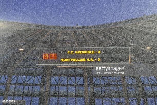 Heavy snow falls on the Stade des Alpes in Grenoble on February 21 2015 ahead of the French Top 14 rugby union match between Grenoble and Montpellier...