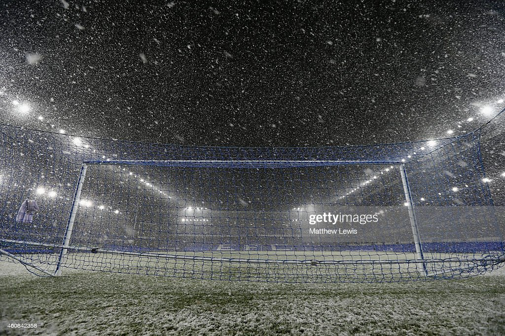 Heavy snow falls the Barclays Premier League match between Everton and Stoke City at Goodison Park on December 26, 2014 in Liverpool, England.