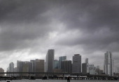 Heavy storm clouds hover over the skyline of downtown Miami Florida as Tropical Storm Isaac's weather band reaches the area on Sunday August 26 2012