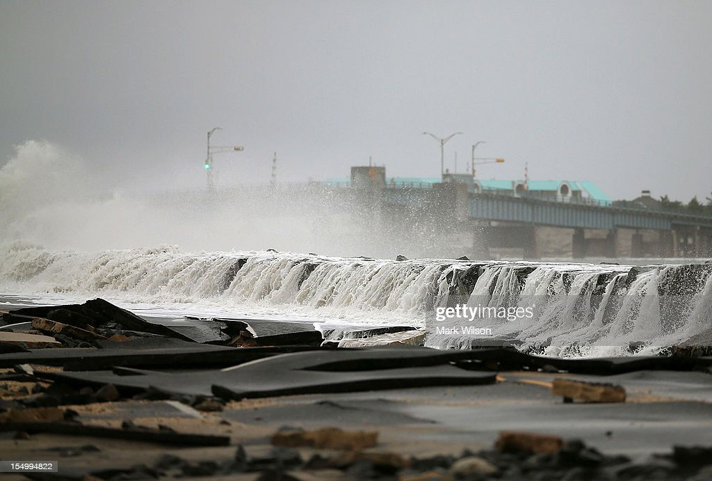 Heavy surf caused by Hurricane Sandy buckles Ocean Ave on October 30, 2012 in Avalon, New Jersey. The storm has claimed at least 33 lives in the United States, and has caused massive flooding across much of the Atlantic seaboard. US President Barack Obama has declared the situation a 'major disaster' for large areas of the US East Coast including New York City, with wide spread power outages and significant flooding in parts of the city.