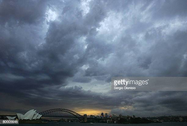 Heavy thunderstorm clouds form over Sydney Opera house and Sydney Harbour Bridge on February 26 2008 in Sydney Australia The Bureau of Meteorology...