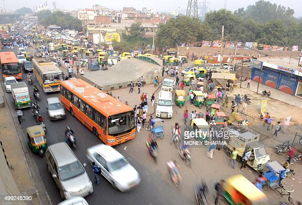 Heavy traffic is seen during a smoggy day in New Delhi on November 30 2015 Some 150 leaders including US President Barack Obama China's Xi Jinping...