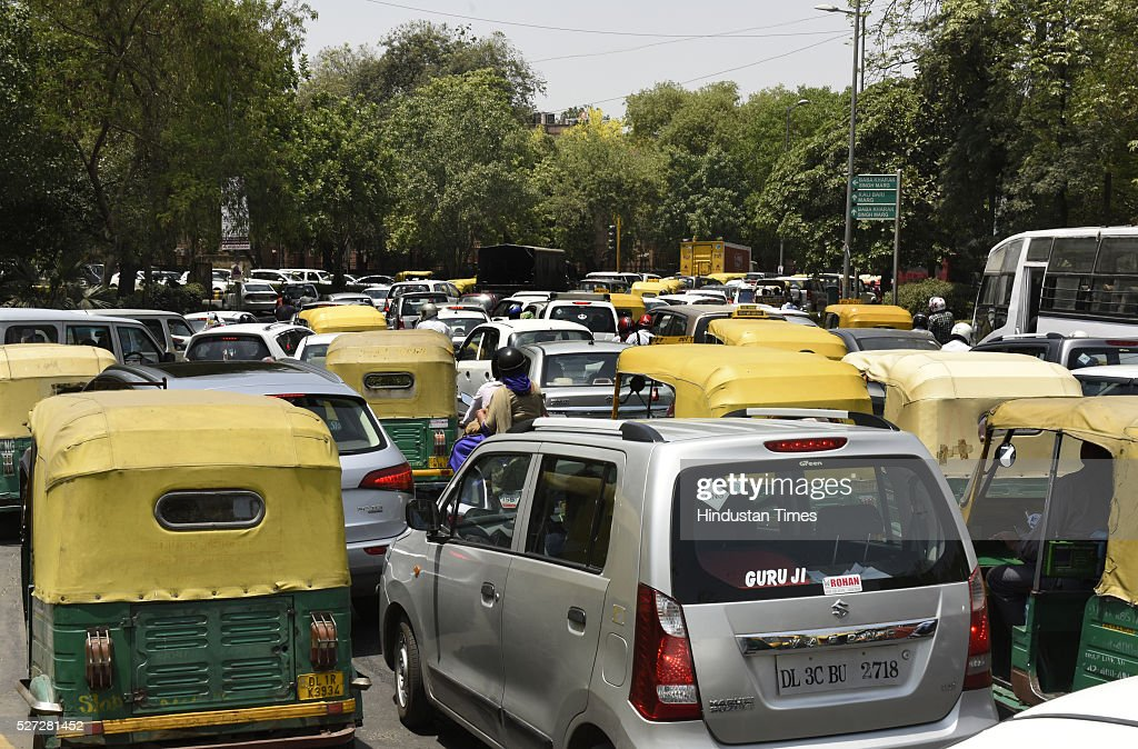 Heavy traffic jam as Diesel Cab owners blocked the road during their protest against the ban on diesel taxis in the national capital at Gole Dak Khana on May 2, 2016 in New Delhi, India. Yesterday, over a hundred diesel-run cabs, including many with AITP, ended up getting impounded after they were found plying within the city limits, following which the drivers alleged harassment by enforcement agencies. After extending the deadline twice, the Supreme Court had refused to give more time to cab operators to convert to CNG and put a ban on diesel cabs in the city from May 1. According to Delhi transport department, about 60,000 taxis are registered in the national capital of which 27,000 run on diesel. Around 2,000 diesel-run taxis had converted into CNG mode in the last two months.