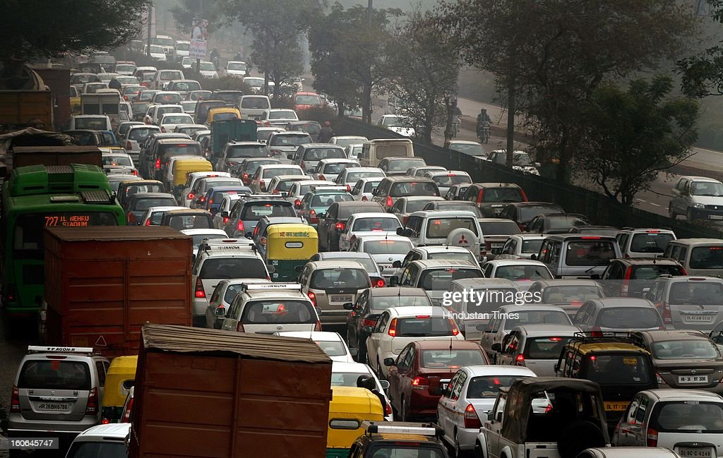Heavy Traffic jam at Outer Ring road near Vasant Vihar due to rains on February 4, 2013 in New Delhi, India. MeT Office has predicted that the capital is likely to experience hailstorms and rains in some parts.