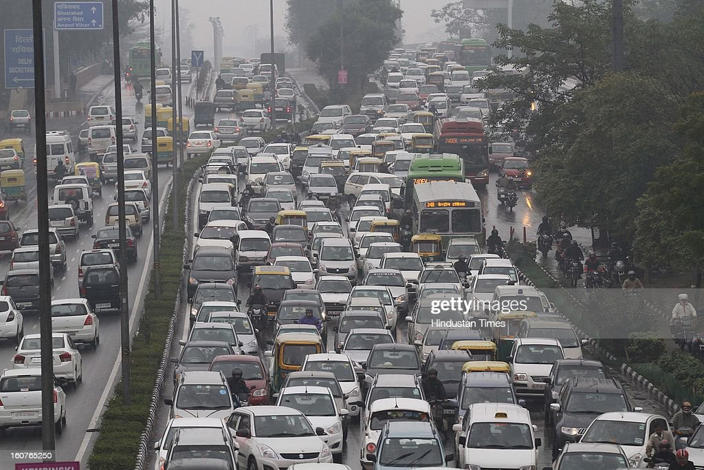Heavy traffic jam at Vikas Marg on February 5, 2013 in New Delhi, India. The persistent rains since late last night break the seven decade old record for the highest rainfall in a single day in February and triggeredmassive traffic jams due to waterlogging across the city.