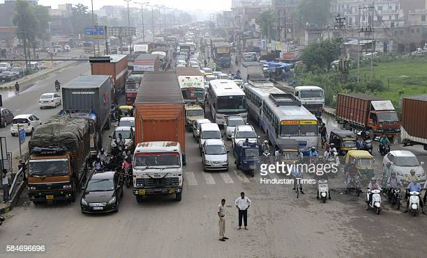 Heavy traffic jam from Rajeev Chowk to Sohna at NH8 due to heavy rainfall as more than 150 vehicles brokedown on the highway due to water entering...