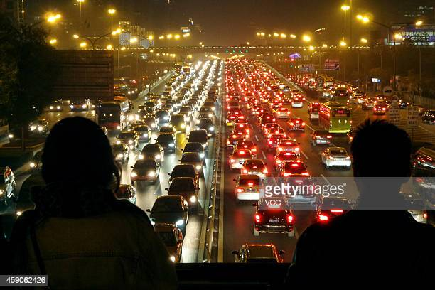 A heavy traffic jam is seen on the road at night on November 15 2014 in Beijing China Beijing's traffic congestion index rose up to 95 during the...