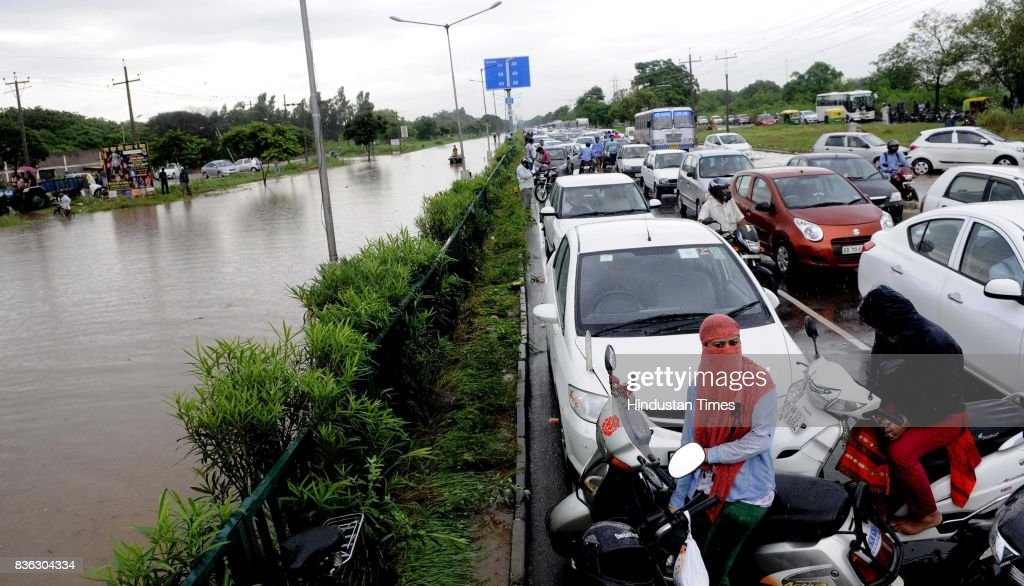 Heavy traffic jam on road due to waterlogging at 45-50 light point due to rain on August 21 2017 in Chandigarh, India. Heavy rainfall on morning brought the tri-city (Chandigarh, Mohali, Panchkula) to a stand still as poor drainage system gave way to roads being flooded with water. The rainfall left the cars of commuters stuck in middle of the roads forcing them to leave their cars stranded.