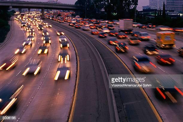 Heavy traffic on freeway at twilight