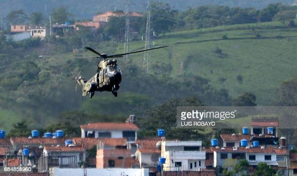 A heavy transport helicopter from the Venezuelan army lands at Paramillo airport in San Cristobal Tachira state Venezuela on May 18 following looting...