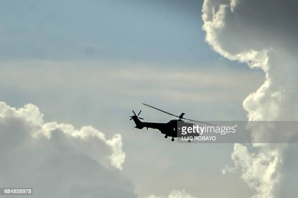 A heavy transport helicopter from the Venezuelan army overflies San Cristobal Tachira state Venezuela on May 18 following looting and attacks against...