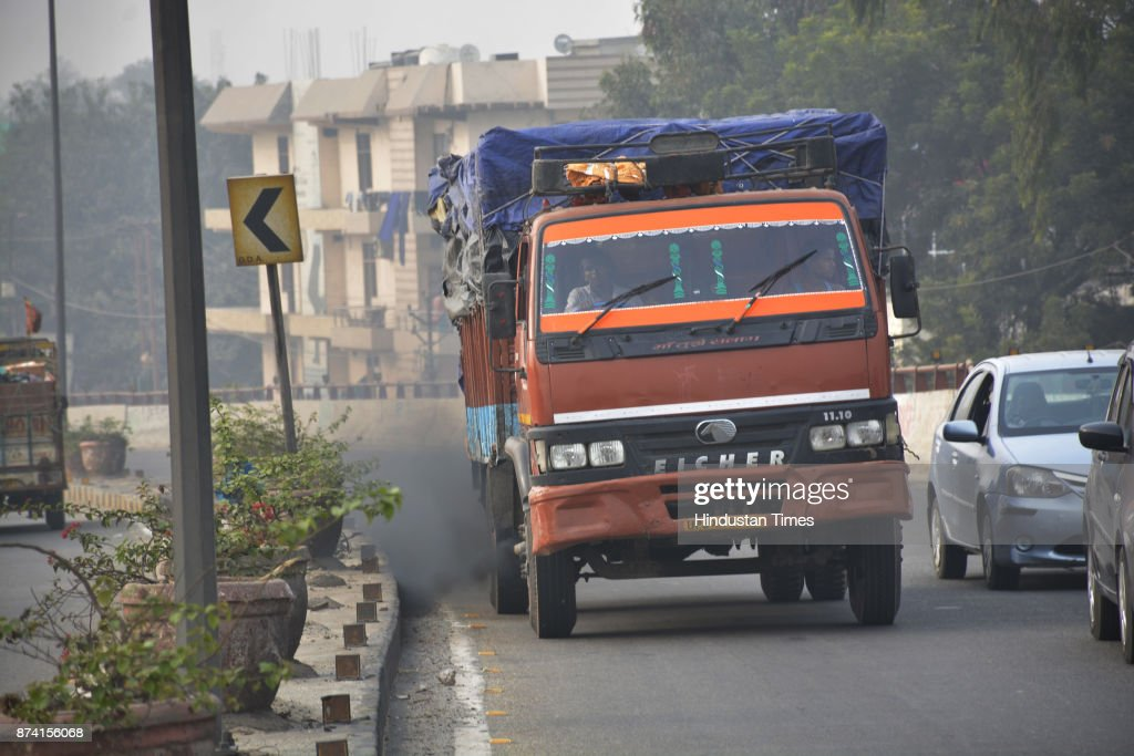 Heavy vehicles seen emitting black smoke near Bulandshahr road Industrial areas on November 14, 2017 in Ghaziabad, India. Delhi battled with severe air pollution on Tuesday as well. The Air Quality Index improved to an average reading of 308, even as the Delhi government extended the ban on entry of trucks. Here are the live updates of the situation in the National Capital Region.