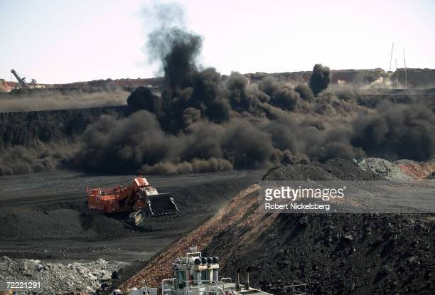 Heavy vehicles stop moving as a timed detonation brings down a wide coal face at the Buckskin Coal Mine on June 13 2006 in Gillette Wyoming The open...