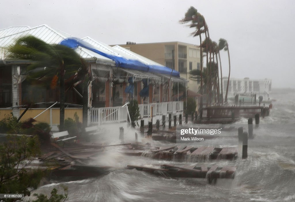 Heavy waves caused by Hurricane Matthew pounds the boat docks at the Sunset Bar and Grill October 7 2016 on Cocoa Beach Florida Hurricane Matthew...
