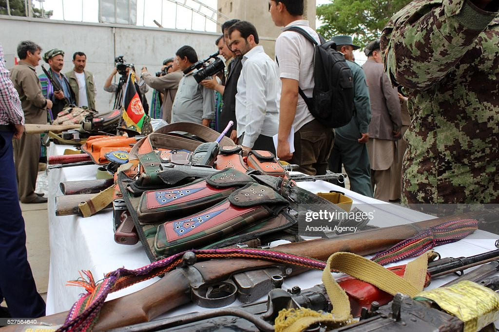 Heavy weapons and varied ammunitions are seen after seventeen Taliban militants laid their arms down and surrendered to Afghani security forces in Cevizcan, Afghanistan on May 3, 2016.