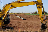 Heavy Yellow Crane Machine Building a Natural Gas Pipeline; Natural Gas is a relatively clean and abundant form of energy that the US is turning to in order to move away from oil. This image shots the