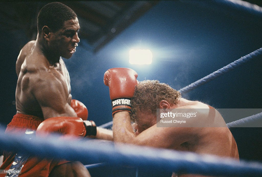 Heavyweight boxer <a gi-track='captionPersonalityLinkClicked' href=/galleries/search?phrase=Frank+Bruno&family=editorial&specificpeople=228066 ng-click='$event.stopPropagation()'>Frank Bruno</a> (left) on the attack in the 8th round during his fight against <a gi-track='captionPersonalityLinkClicked' href=/galleries/search?phrase=Joe+Bugner&family=editorial&specificpeople=239003 ng-click='$event.stopPropagation()'>Joe Bugner</a> on 24th October 1987 at White Hart Lane, London, Great Britain.