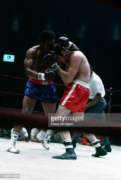 Heavyweight boxer George Foreman left throws a punch in a heavyweight fight circa 1970