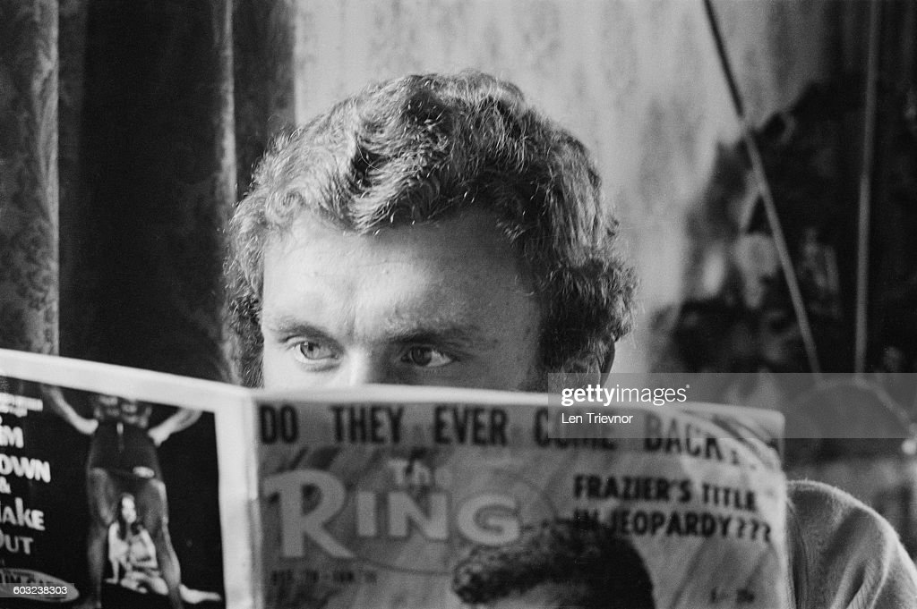 Heavyweight boxer <a gi-track='captionPersonalityLinkClicked' href=/galleries/search?phrase=Joe+Bugner&family=editorial&specificpeople=239003 ng-click='$event.stopPropagation()'>Joe Bugner</a> reading the boxing and wrestling periodical 'The Ring', UK, 3rd February 1971.