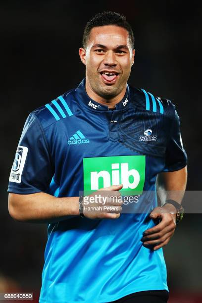 Heavyweight boxer Joseph Parker runs off after delivering the match ball during the round 14 Super Rugby match between the Blues and the Chiefs and...